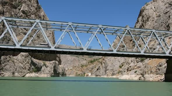 Cover Image for Iron Car Bridge Between Mountains Above River