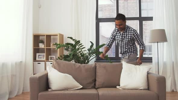 Thumbnail for Indian Man Arranging Sofa Cushions at Home 105
