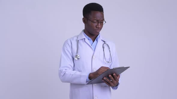 Thumbnail for Young Happy African Man Doctor Holding Clipboard