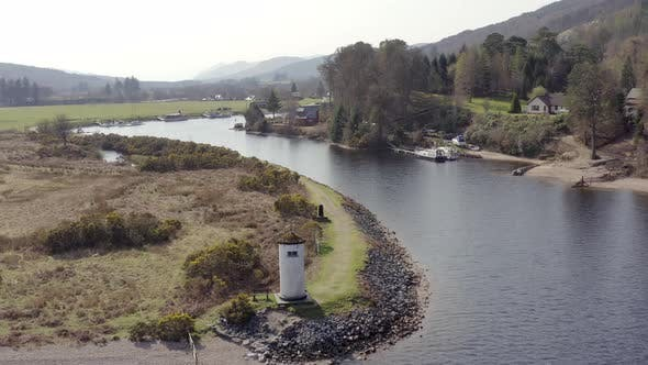 Head of a Loch in Scotland with a Small Lighthouse