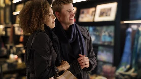 Thumbnail for Attractive young couple browsing inside shop