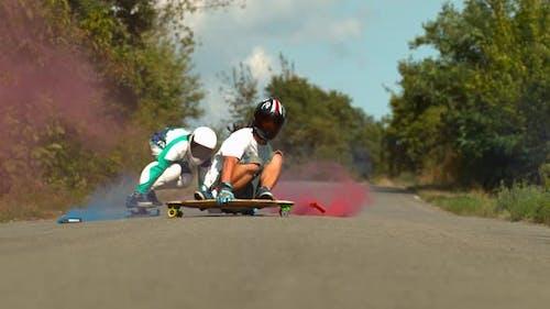 Longboarders through smoke, slow motion