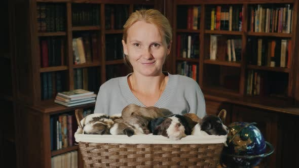 Thumbnail for Portrait of a Woman with a Basket Full of Little Puppies
