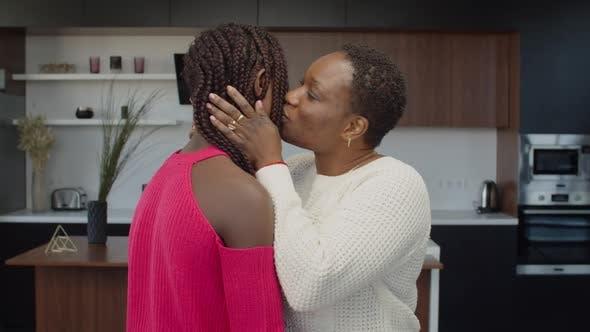African Mom and Teenage Girl Expressing Warm Feelings