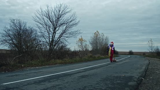 A Scary Clown Pulls A Hammer Down The Road