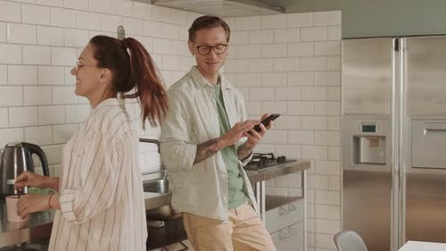 Young Couple Communicating in Kitchen
