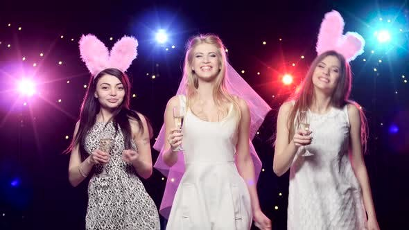Thumbnail for Happy Bride with Girlfriends Dancing Drinking Champagne at Bachelorette Party