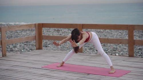 Woman Is Performing Yoga Asana Outdoors, Hatha Yoga Practice