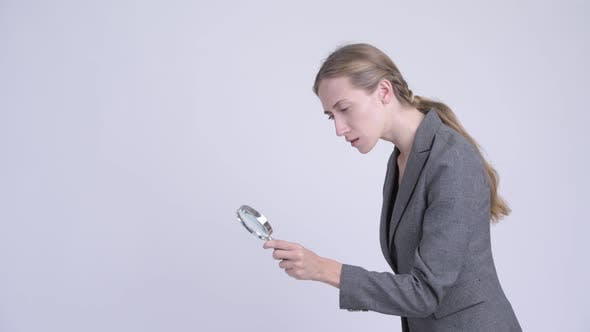 Thumbnail for Young Blonde Businesswoman Using Magnifying Glass