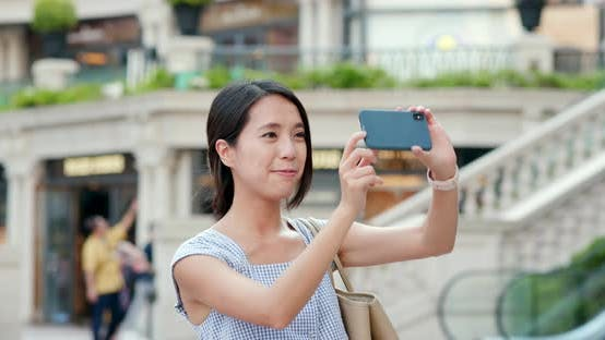 Thumbnail for Woman taking photo on cellphone at outdoor