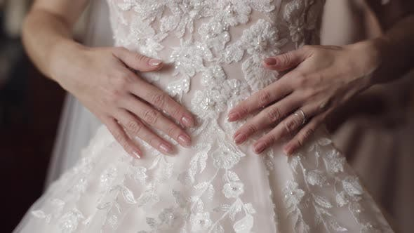 Thumbnail for Beautiful and Lovely Bride Touches Her Wedding Dress with Her Hands. Slow Motion