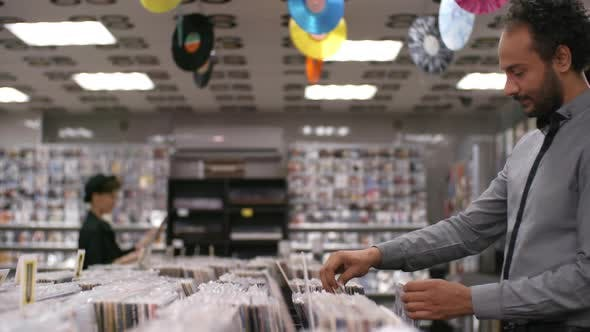 Thumbnail for Multiethnic Customers Perusing Merchandise in Record Shop