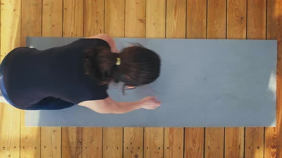 Slim Woman in Tracksuit Stands to Do Push Ups on Grey Mat