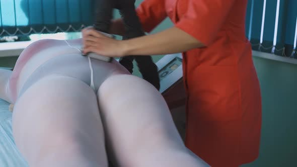 Thumbnail for Plus-size Lady in Suit Undergoes Vacuum Roller Massage