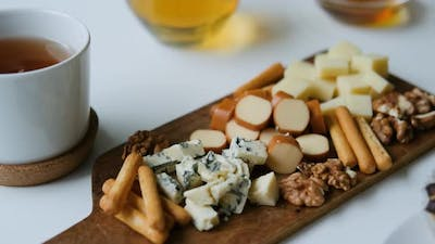 cheese snack with nuts on the board