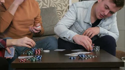 Teen Poker Players Betting Chips in Poker Game