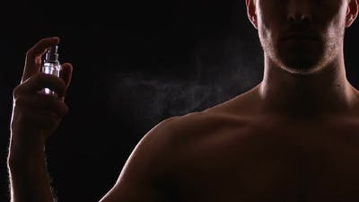 Athletic Man Spraying Perfumes on Torso, Seductive Fragrance for Dating, Slow-Mo