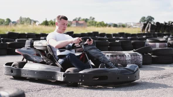 Thumbnail for Attractive Man Sititng in a Gocart on the Track