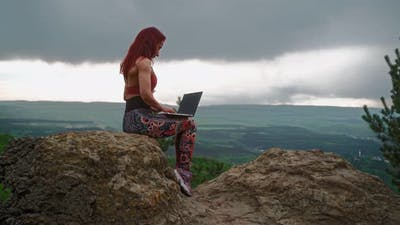 Woman Writer is Typing on Laptop Stunning Landscape