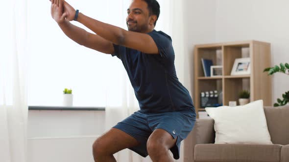 Cover Image for Indian Man Exercising and Doing Squats at Home
