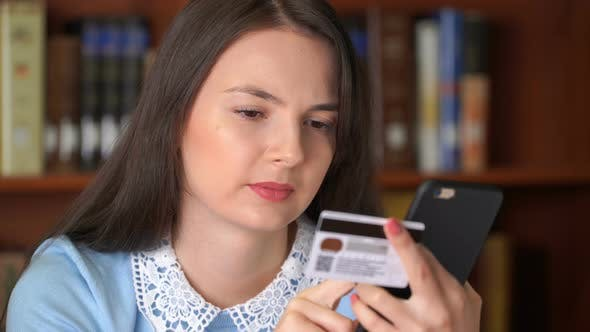 Thumbnail for Pretty Woman Shopping Online with Easy Pay Using Smartphone and Credit Card