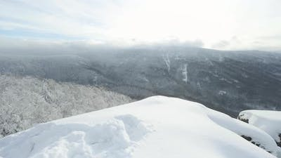 A Snowcovered Hilly Winter Landscape with Woods  Top View