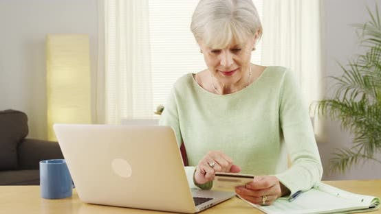 Thumbnail for Senior woman online shopping computer laptop