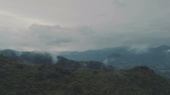 Thumbnail for Misty Clouds Over Hills and Forests. Cloudy Sky