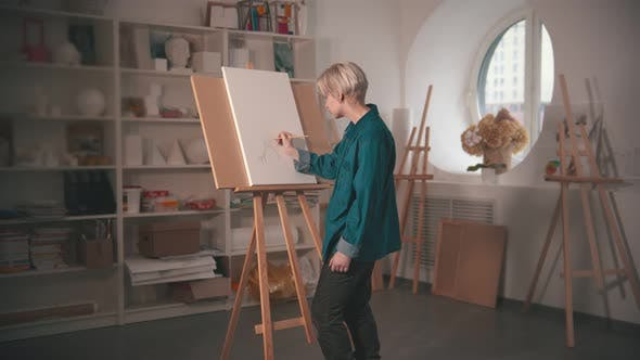 Thumbnail for A Young Blonde Woman Artist Drawing Sketch on the Canvas and Looking at It