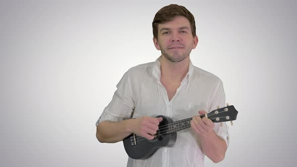 Cover Image for Man with Ukulele Singing a Song on Gradient Background