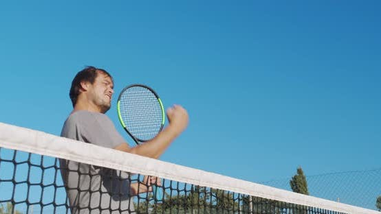 Cover Image for Male Athlete Playing Tennis on Outdoors Hard Court, Happy Man in Celebration of Success and Win