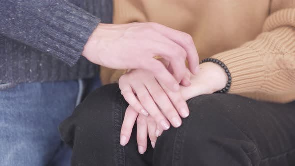 Thumbnail for Young Man Taking Woman's Hand Close-up. Unrecognizable Boyfriend and Girlfriend Holding Hands
