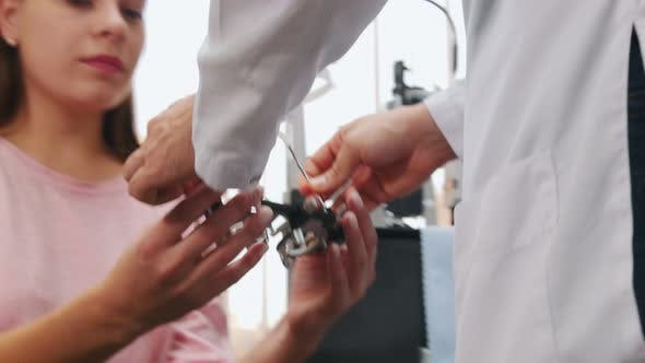Putting on an Optometry Device for Vision Test with Lenses