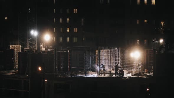 Thumbnail for Construction Site Residential Building, Welding Instrument Workers Construct at Winter Night