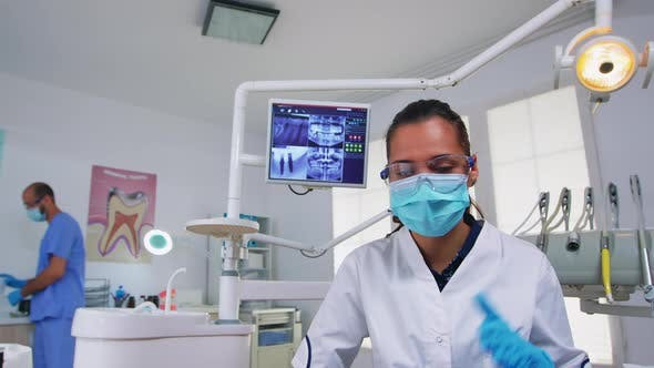 Thumbnail for Doctor Specialist Talking with Patient in Stomatology Clinic