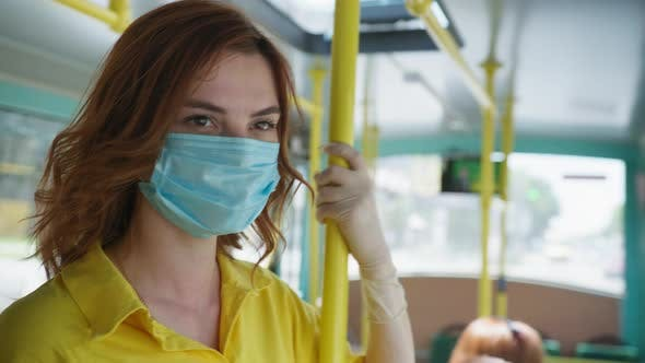 Thumbnail for Girl in Medical Mask To Protect Against Virus and Infection Removes During Trip To City on Public