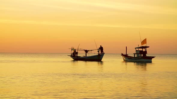 Thumbnail for Fisher Boats at Sunset on the Horizon