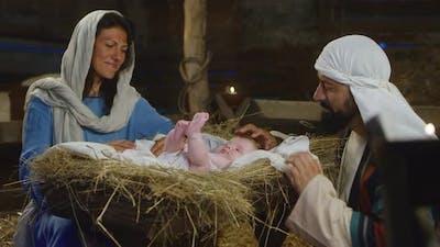 Mary and Joseph Admiring Son of God