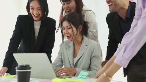 Business People Celebrate Success of Proficiently Finished Project