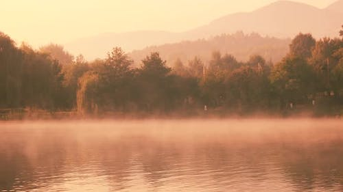 Panoramic View From Misty Lake in the Early Morning