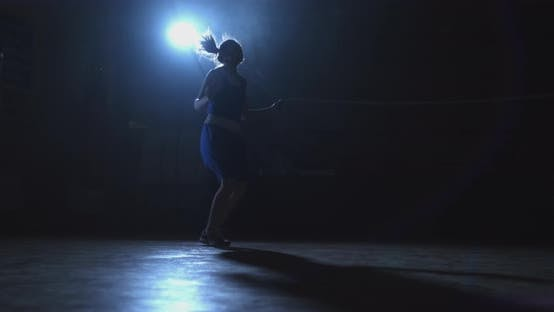 Thumbnail for Young Beautiful Female Boxer Training in the Gym Skipping Rope the Movement of the Camera Slide