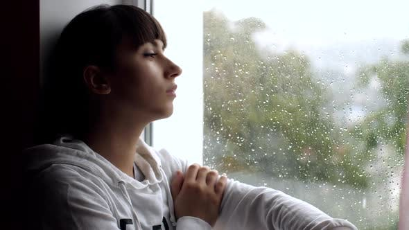 Thumbnail for Depressed Young Woman Near Window at Home