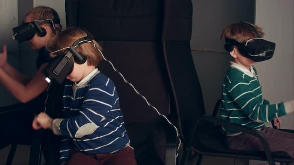 Thumbnail for Two Boys and a Girl Playing Virtual Reality Game