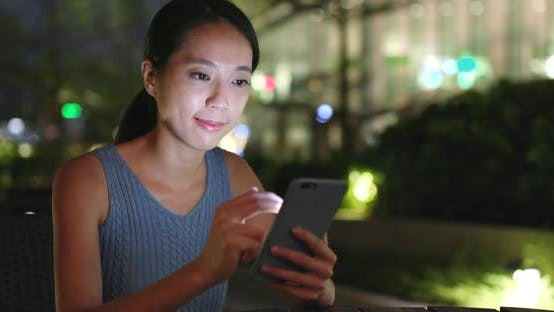 Cover Image for Woman use of smart phone at night