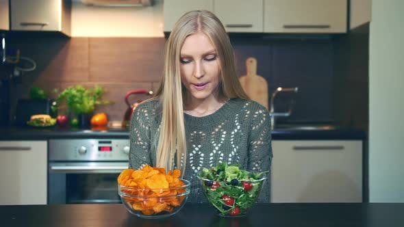 Thumbnail for Young Woman Preferring Salad To Crisp
