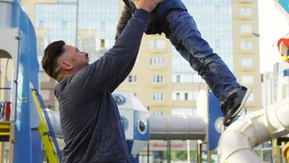 Cover Image for Happy Caucasian Father Tossing Young Son Up in Air