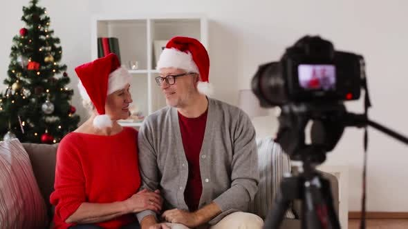 Thumbnail for Senior Couple Recording Christmas Video on Camera 129
