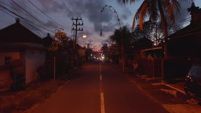 Motorcycles Driving on a Dark Street in Bali Indonesia