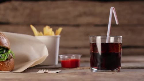 Burger with Cola and Sauce.