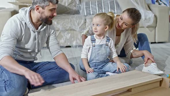 Thumbnail for Family Unpacking Wooden Furniture